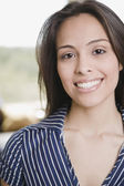 Confident Hispanic woman smiling — Stockfoto