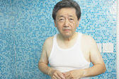 Worrying Asian man in bathroom — Stock Photo