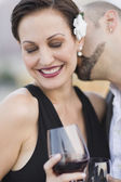 Cuban man kissing Cuban woman's neck — Stock Photo