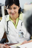 Kazakh female doctor listening to patient — Stock Photo