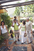 Multi-generational family standing outdoors — Stock Photo