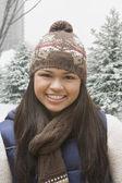 Hispanic girl in stocking cap and scarf outdoors — Foto de Stock