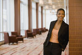 African businesswoman laughing in lobby — Stock Photo
