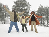 African family playing in the snow — Stock Photo
