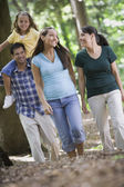 Hispanic family walking in woods — Stock Photo