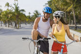 Hispanic couple riding bicycles — Stock Photo