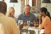 Friends eating at dinner party — Stock Photo