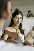 Hispanic woman getting coffee at cafe — Stock Photo
