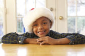 African boy wearing Santa hat — Stock Photo