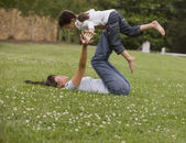 Asian mother playing with daughter in park — Stock Photo