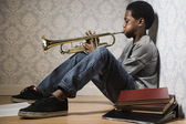 African boy playing trumpet — Stock Photo