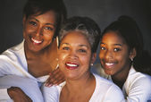Multi-generational African female family members smiling — Stock Photo