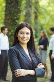 Hispanic businesswoman posing with arms crossed — Stock Photo