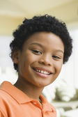Close up of smiling mixed race boy — Stock Photo