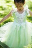 Hispanic girl in party dress dancing outdoors — Stock Photo