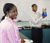 Confident African student in chemistry lab — Stock Photo