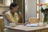 Native American using laptop during breakfast — Stock Photo