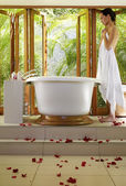 Pacific Islander woman standing next to bathtub — Stock Photo