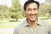 Portrait of Asian man outdoors — Stock Photo