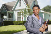 Portrait of African woman in front of house — Stock Photo