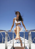 Pacific Islander woman on yacht — Stock Photo