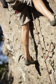 Close up of Argentinean man rock climbing — Stock Photo