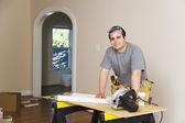 Hispanic man remodeling interior of home — Stock Photo