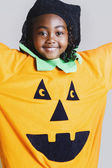 African girl wearing pumpkin costume — Stok fotoğraf