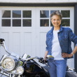 Senior African American woman next to motorcycle — Stock Photo