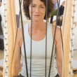 Senior woman sitting in exercise equipment — Stock fotografie