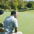 Hispanic man on golf course — Stock Photo