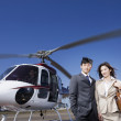 Asian businesspeople next to helicopter — Stock Photo #26292937