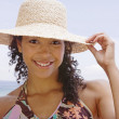 African American woman wearing sun hat — Stock Photo