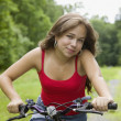 Hispanic girl riding bicycle — Stock Photo