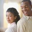 African American couple standing back to back — Stockfoto