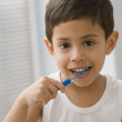 Hispanic boy brushing teeth — Foto Stock