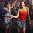 Hispanic friends dancing at nightclub — Stock Photo