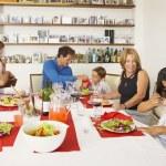 Multi-generational Hispanic family eating dinner — Stock Photo #26293187