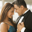 Hispanic couple dancing in eveningwear — Stockfoto