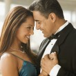 Hispanic couple dancing in eveningwear — Stock Photo