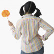 Rear view of Chinese woman holding lollipop — Stock Photo