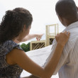 African American couple holding blueprints at new construction — Stock Photo