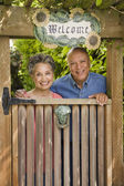 Senior African American couple looking over gate — Stock Photo