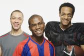 Group of multi-ethnic male athletes — Stock Photo