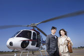 Asian businesspeople next to helicopter — 图库照片
