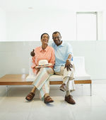 Senior African couple sitting on bench — Stock Photo