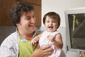 Hispanic father holding baby daughter — Stock Photo