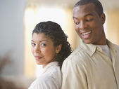 African American couple standing back to back — Stock Photo