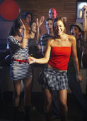 Hispanic friends dancing at nightclub — Stock Photo