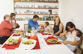Multi-generational Hispanic family eating dinner — Stock Photo
